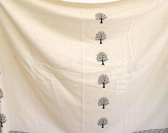 Unbleached cotton fabric with Burgundy border and small black tree pattern