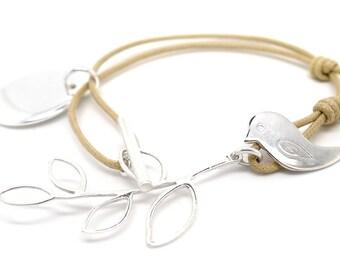 Bird and its arm bracelet