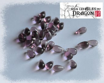 30 drops of purple glass beads