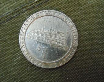One Dollar token from Biloxi Belle Gambling Boat casino