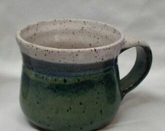 Stoneware mugs hand thrown on the stoneridges of the Ozarks'.