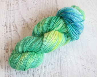 Variegated Superwash DK Weight Yarn (100% Superwash Merino) Hand Dyed in multiple shades green, blue, and yellow