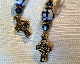 Blue and white gold plated post pierced earrings with Celtic knot Celtic cross charms.
