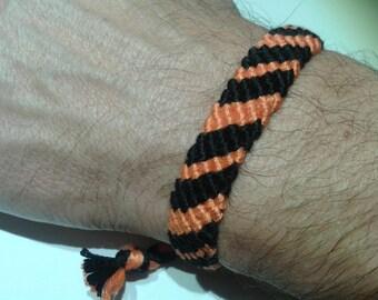 Orange and black Friendship Bracelet adjustable.