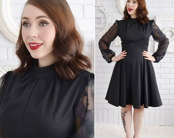 Vintage 1970s Black Polyester Dress with Skater Skirt and Sheer Nylon Sleeves Size XS