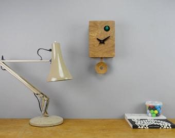 Modern Cuckoo Clock in Walnut finish, moving birdie and pendulum