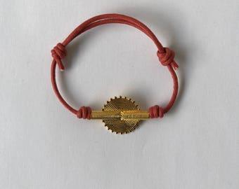 Sassandras cord bracelet with a vermeil bead.