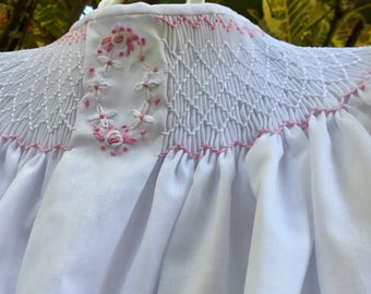 Hand smocked dress with embroidered flowers