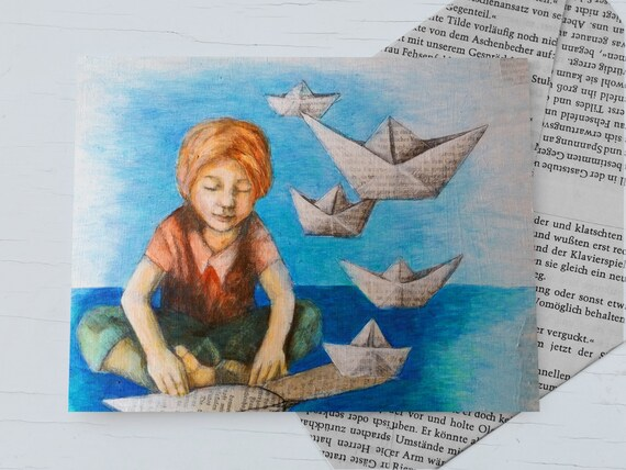 Paper ship, gift card for bookworms, a boy reading a book, hovering from the book pages, paper ship, card reader maritime
