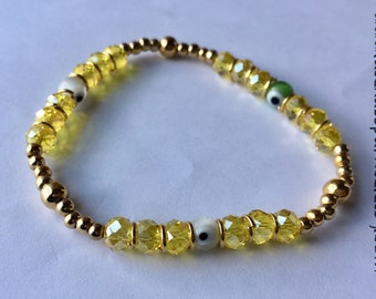Yellow Spiritual Turkish (evil) eye glass beaded bracelet - Pulsera de piedritas de cristal amarilla con ojos Turcos de vidrio
