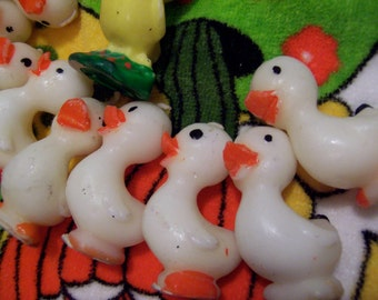 collection of white ducks and a chick candles