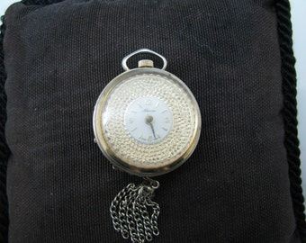 c493 Unique Vintage Lapel Watch/ Pendant Watch Round with a Rotating Bezel