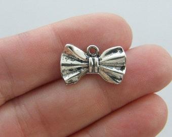 8 Bowtie charms antique silver tone CA141