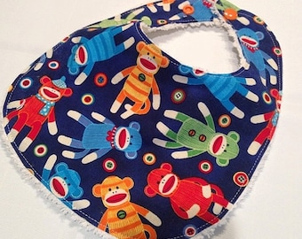 Spring Sale Sock Monkey - Infant or Toddler Bib - Terry Cloth Backing - Reversible with ADJUSTABLE Snaps