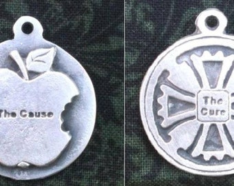 The Cause and The Cure two-sided pewter pendant or key fob.