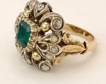 18k Gold Silver rose cut Diamond Emerald Cocktail Ring. Size 6.25, weighs 13.3 grams. Gemstones have not been graded for color and clarity.