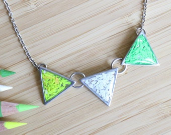 Colored pencils recycled into triangle pendant, pewter and resin