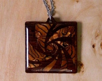 Square wooden necklace inlaid with golden pearloid