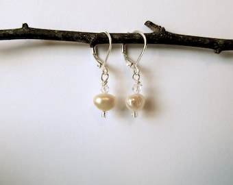Silver plated earrings with clear glass, white pearls, and clear crystal beads