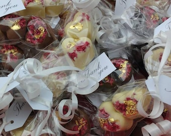 Decadent gold leaf and raspberry heart wedding favours. Belgian chocolate. Just married