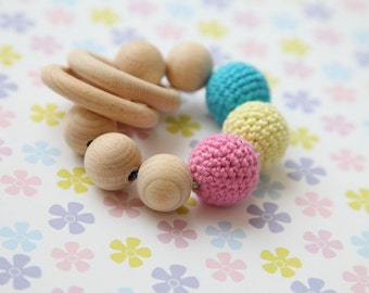 Teething toy with crochet yellow, pink and blue wooden beads and 2 wooden rings. Wooden rattle. Gift for baby.