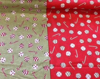 Clothworks baubles in red or green by the half metre