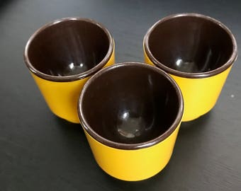 3 Vintage Plastic EGG CUPS  from West Germany (I think) / yellow brown / 70s or 80s