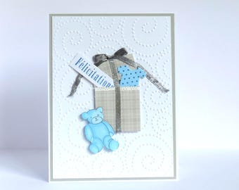 congratulations, baby boy card. Blue and white gift box