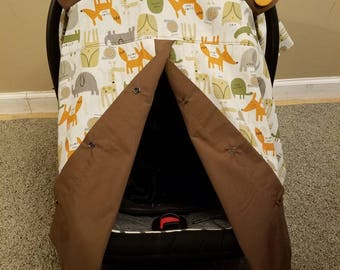 Animal carseat canopy with fox, owl, alligator, turtle, snail. In neutral colors beige, brown, green, orange.