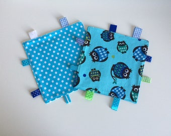 Blue cuddly wipes with owls and dots