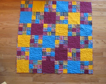 Fiesta: bright lap quilt in turquoise, orange, and maroon
