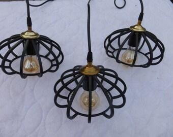 Three sleek black pendant lights hanging ceiling suspended modern