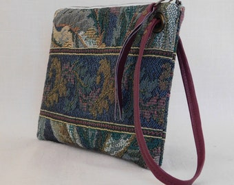 Clutch with wrist strap in green tapestry and wine reclaimed leather