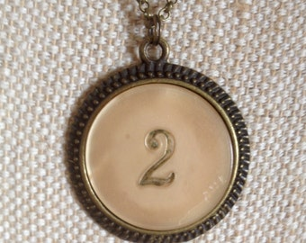 CLEARANCE! Celluloid poker chip pendant number two / bronze tone setting / 60cm belcher chain