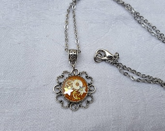 Retro resin inclusion, yellow and silver pendant, watch gears and stars