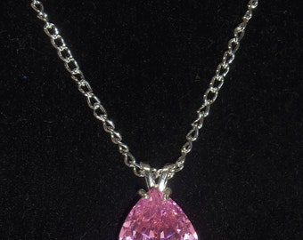 28.11 Cts. - Synthetic Pink Sapphire - Faceted Pear Cut- Stirling Silver Setting- 26in Silver plated chain