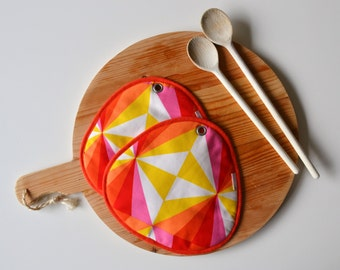 orange potholders, funky geometric shapes print potholders, orange, yellow, white and pink potholders, mod kitchen potholders, foodie gift