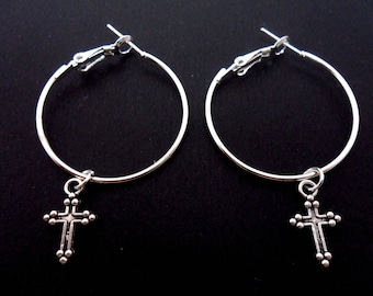 "A pair of silver plated 30mm 1"" hoop and cross earrings."