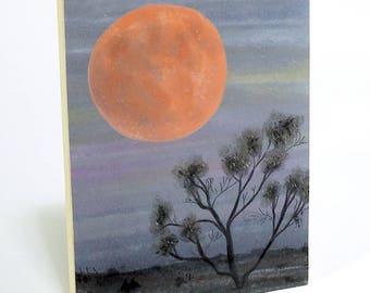 Pink Moon print on wood