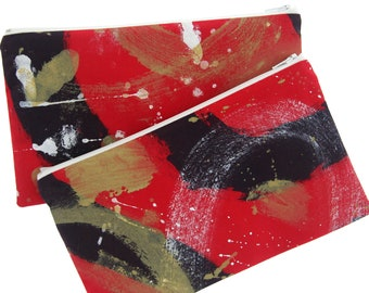 Travel pouch/zippered bag, made with painted fabric, waterproof lining.
