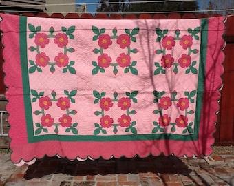Antique pink floral quilt
