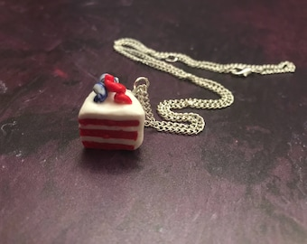 Handmade red velvet cake slice necklace.