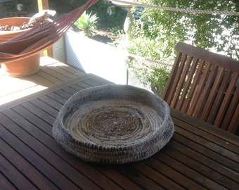 Woven basket, using recycled materials.