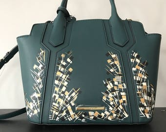 Ivory and gold on forrest green bag