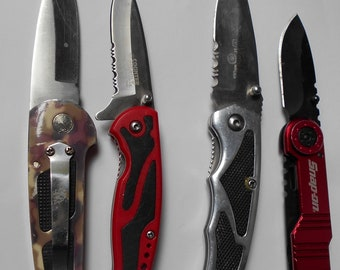 Four Used High Tech Styled POCKET Knives.