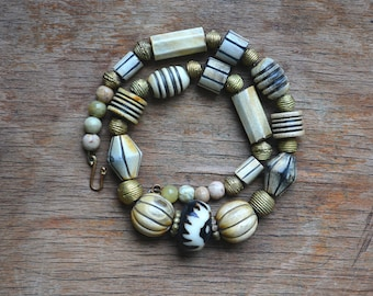 African bone bead necklace with African brass