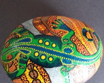 Hand painted, large, sea smoothed Welsh beach pebble with aboriginal style lizard.