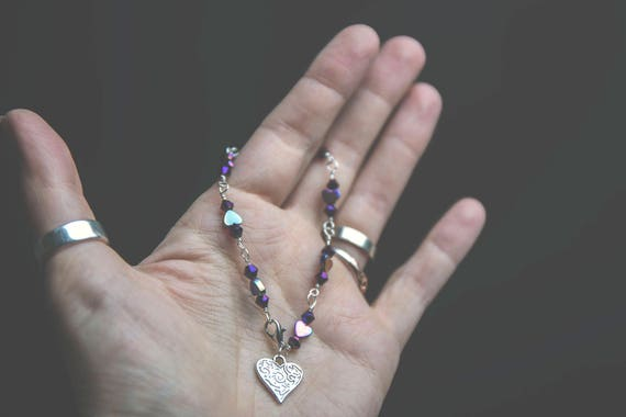 Delicate Sterling Silver bracelet with Rainbow Hematite and Purple Faceted Crystals.
