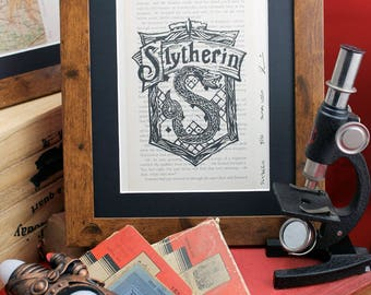 Slytherin linocut on upcycled Harry Potter book. Limited edition Order of the Phoenix lino print inc.  Gryffindor, Ravenclaw & Hufflepuff