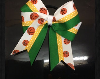 Basketballs with Green and Gold Tiny Dots down the Middle and a White Glitter Center Hairbow